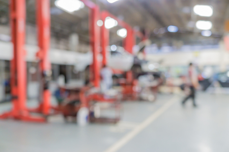 fix: Blurred of car technician repairing the car in garage background. Stock Photo