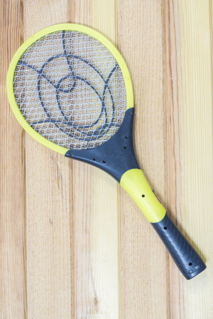 albopictus: Electronic mosquitoes killer swatter  on  wooden background Stock Photo
