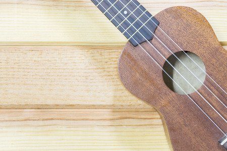 Close up of ukulele on old wooden background - can be used for montage or display your word.