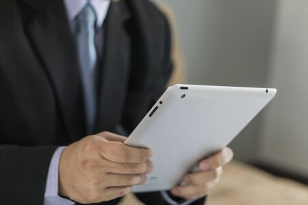 asian business: Asian Business man use tablet pc Stock Photo