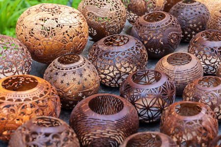 wood craft: Coconut shell carving,Handicraft of indigenous people in Bali, Indonesia.