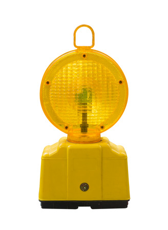 accident at work: warning light in yellow,Construction site is protected by fence with flashing beacon lights for safety.isolate,on white background. Stock Photo
