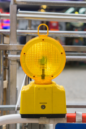 warning lights: warning light in yellow,Construction site is protected by fence with flashing beacon lights for safety.