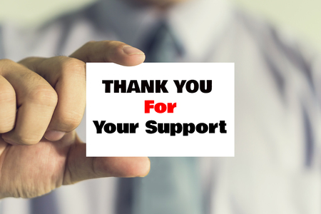 businessman showing business card with Thank you for your support message on the card shown by a man, vintage tone.