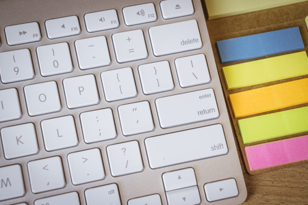 delete button: worker typing on the keyboard,Enter ,Shift ,delete button from a Mac keyboard