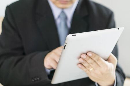 asian businessman: Asian Business man use tablet pc Stock Photo