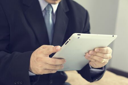 asian business: Asian Business man use tablet pc,vintage color. Stock Photo
