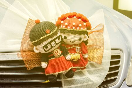 wedding ceremony: Chinese Wedding doll ,Trapped in car,wedding ceremony in hong kong ,china,Traditional Chinese wedding scenes,vintage color. Stock Photo