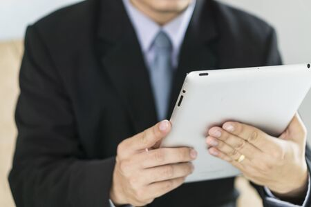 asian business man: Asian Business man use tablet pc Stock Photo