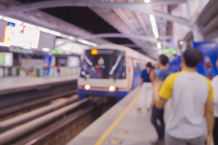 Abstract blur or defocus Background of People waiting for Boarding Skytrain or Monorail train or MRT,Blurred city people lifestyle background,vintage color