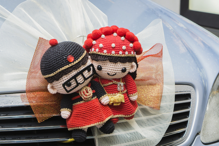 asian family: Chinese Wedding doll ,Trapped in car,wedding ceremony in hong kong ,china,Traditional Chinese wedding scenes,vintage color. Stock Photo
