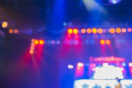 blurred background of night bokeh light,abstract texture background concert light background illumination,Blurred stage lights a rock concert,Stage spotlights,vintage color