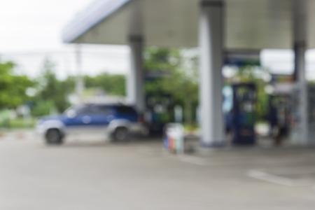 gasolinera: fondo borroso de la estaci�n de servicio, fuera de la estaci�n de gas de enfoque, la gasolinera y tienda de conveniencia