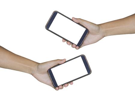 白い背景で隔離のスマート フォンを持っている 2 つの手、孤立した男性の手が白い画面で携帯電話を保持