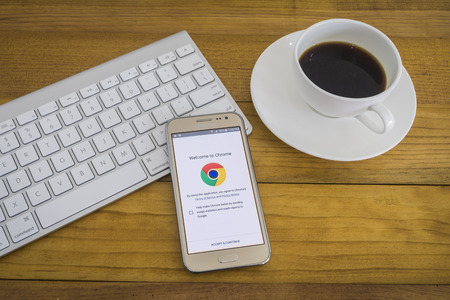CHIANGMAI, THAILAND Jan 1, 2016:A  smartphone device open google chrome application,google app open in the mobile phone,welcome to google chrome.