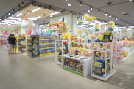 blurred background of  toys department store,Natural bokeh shopping mall Toy Store,vintage color. Imagens