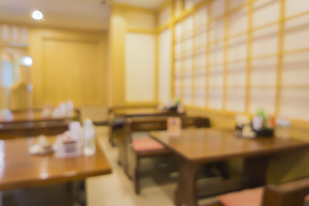 Abstract Blurred background image of japan restaurant blur background with bokeh,tables of oriental style interior of the asian, japanese restaurant. Stock Photo