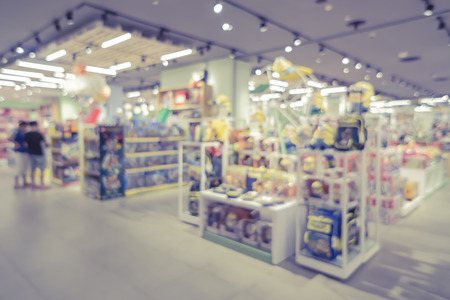 shop window display: blurred background of  toys department store,Natural bokeh shopping mall Toy Store,vintage color. Stock Photo