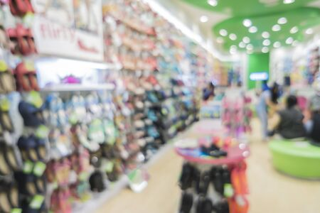 sporting goods: Blur of city shopping people crowd at marketplace shoe shop abstract background.