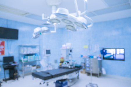 Blur of equipment and medical devices in modern operating room take with art lighting and blue filter,operating room with modern equipment.Operating room ready for operation Фото со стока