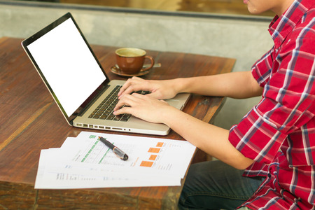 man's hands keyboarding on net-book while sitting at the wooden table in cafe,student working  laptop computer with copy space screen for your text ,male freelancer sitting front laptop computer
