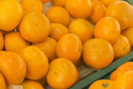 ash gourd: oranges fruit on market stall,with chinese new year background, in market,selective focus.