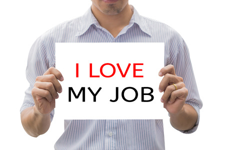 I love my job message on the card shown by a man,Human hands holding blank advertising card isolated on white background,asian business man show white card in hand ,business man outdoor,gay man,selective focus,vintage color. Imagens