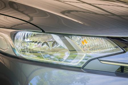 headlights: Close-up photo of retro car headlights,Closeup headlights of modern car,Closeup headlights of car.