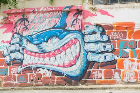 contradiction: HONG KONG - October 11:Hong Kong,STREET ART GALLERY SHOWS,  Oct. 11, 2015,Graffiti is a common find in Hong Kong and Sheung Wan is a highly popular place for graffiti and street art,Hong Kong, China