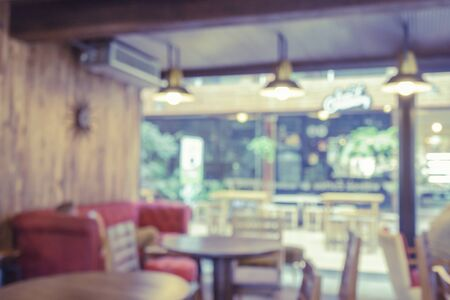 light duty: Blur or Defocus image of Coffee Shop or Cafeteria ,Customer at restaurant blur background with bokeh for use as Background,vintage retro color