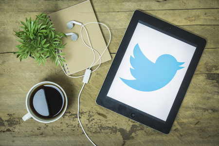 microblogging: CHIANGMAI, THAILAND -jan 2,2016:Apple ipad open Twitter application,Twitter is an online social networking and microblogging service that enables users to send and read tweets