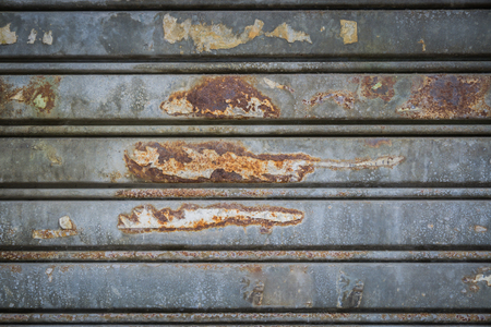 corrugated metal: old metal texture surface,old Wide shot of silver corrugated metal with bolts
