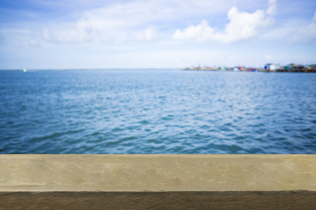 Empty top of wooden table or counter and view of tropical beach. For product display Stock Photo