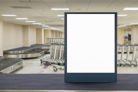 advertise: Empty blank billboard at airport ,train station,blank billboard - blank billboard advertising public commercial,ready for new advertisement,selective focus Stock Photo