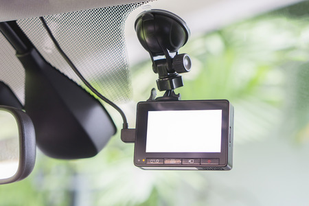 car video recorder installed on the window,with blank screen,copyspace ,selective focus.at sunset,vintage color Imagens - 62834515