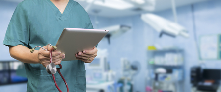 estudiantes medicina: Male doctor,medical students or surgeon using digital tablet and laptop during the conference,Health Check with digital system support for patient,test results and patient registration,selective focus
