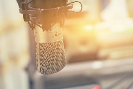 audio and studio recording concept, Microphone in a recording studio or concert hall ,above recording studio mixer sound audio mixing console board,selective focus,vintage color Stock Photo