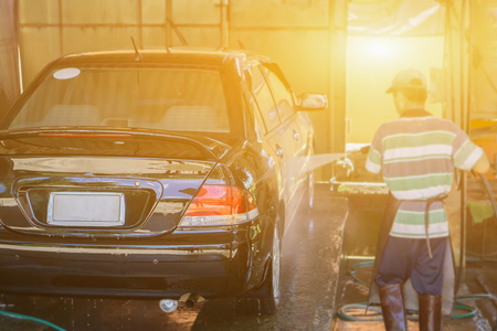 car washing by hand using a foam preparation for polishing,cars in a carwash,selective focus