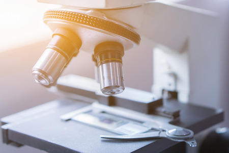 medical laboratory, scientist hands using microscope for chemistry test samples,examining samples and liquid,Medical equipment. microscope,Scientific and healthcare research background.vintage color 写真素材