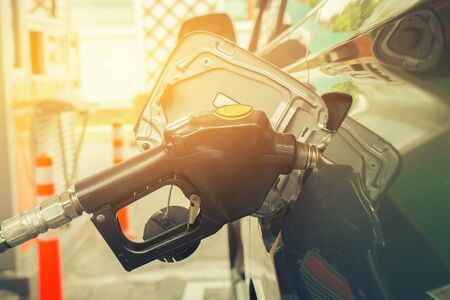 unleaded: Refill and filling Oil Gas Fuel at station,vintage color,selective focus