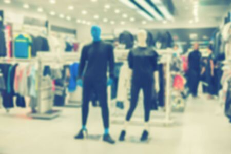 De focused/blurry background of Sports clothing store in Inter Sport store?city shopping people crowd at marketplace shoe shop ,with bokeh image, for product display montage