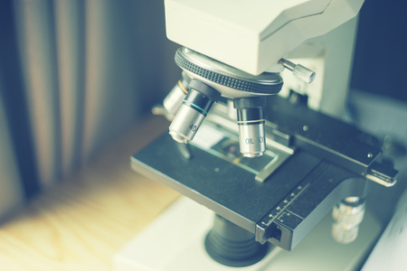 medical laboratory, scientist hands using microscope for chemistry test samples,examining samples and liquid,Medical equipment. microscope,Scientific and healthcare research background.vintage color Imagens
