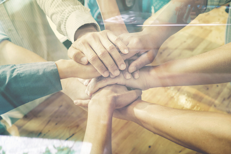 team hands: Teamwork and Support concept,Business people team standing hands holding together in the office.cooperation success business,vintage color