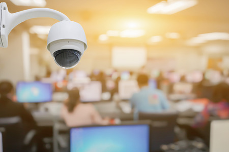Closed-circuit television,CCTV Camera Operating inside Class room,computer room,use video cameras transmit a signal to a specific place,on white background with clipping path.