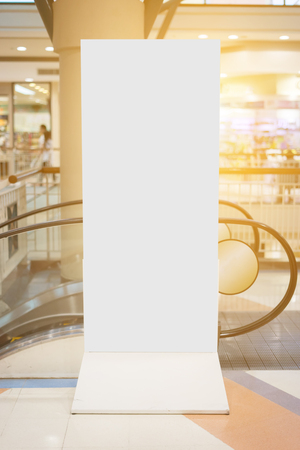 mocked: Blank vertical big poster in public place. Billboard mockup near to escalator in an mall, shopping center, airport terminal, office building or subway station.,can be used for montage or display