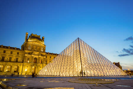 each year: Paris, France - March 25 2016: The Louvre Museum is one of the worlds largest museums and a historic monument with more than 8 million visitors each year. A central landmark of Paris, France.