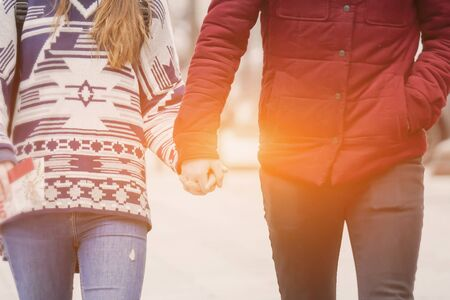 walking away: Couple Holding Hands Walking Away,Couple in love. passion.romantic young couple in love,holidays, vacation, love and friendship concept,couple having fun in park,selective focus ,vintage tone color