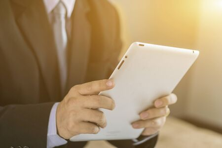 Asian Business man use tablet pc Stock Photo