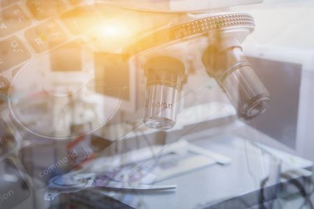 Double exposure of chemistry, biology, medicine and people concept,scientist hand with test sample making research in clinical laboratory, containing chemical liquid, science research,vintage color