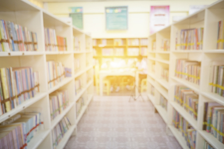 Blurred Shop Background in Book store Shelf Natural bokeh out of focus Bookstore,Blur background of people in library book store,shopping mall background concept,vintage color